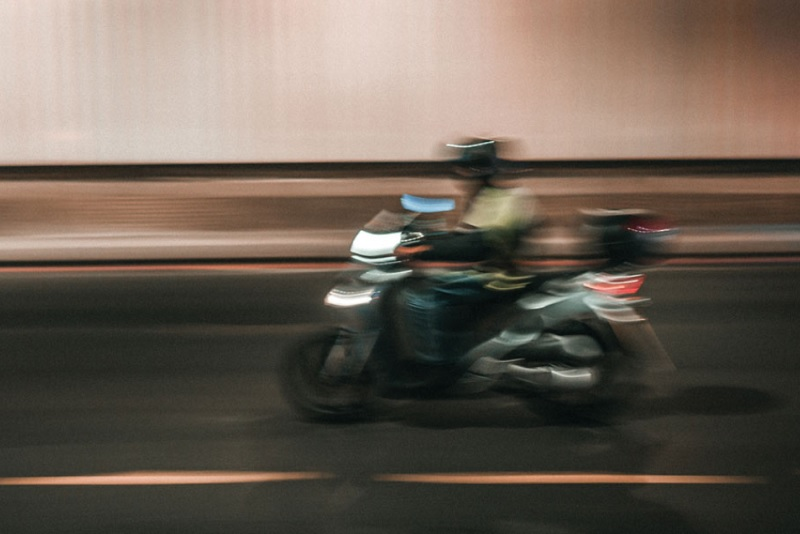 A motorcyclist riding on a road
