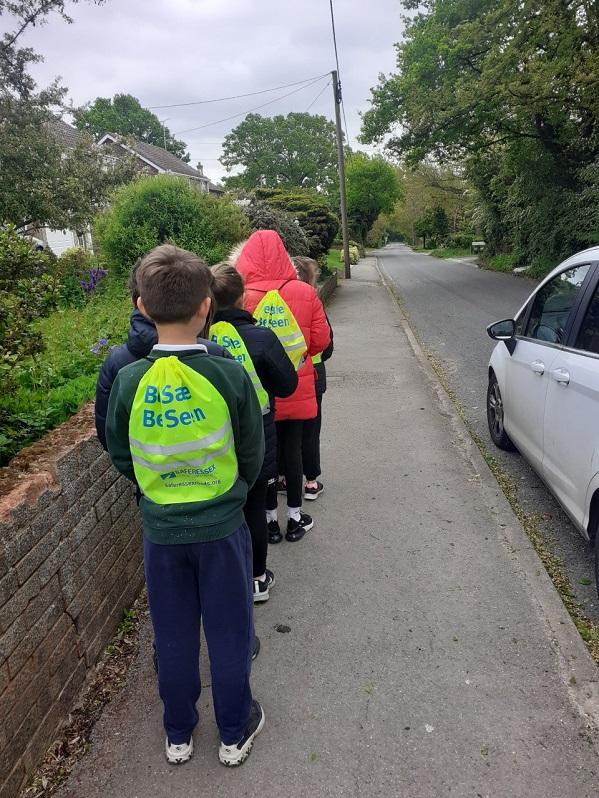 Children wearing hi-vis back packs