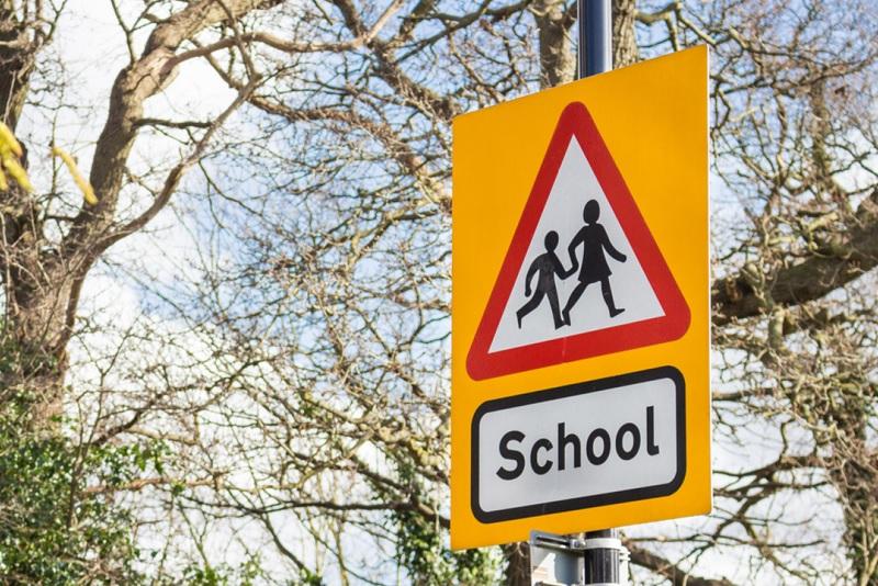 A school crossing patrol sign